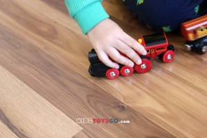 kid plays Brio mighty red locomotive