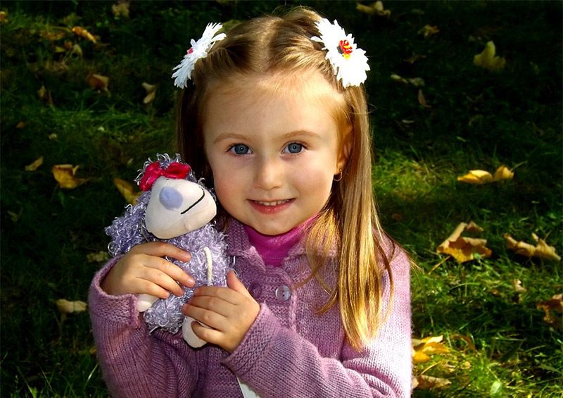 Baby Girl and Stuffed Toys