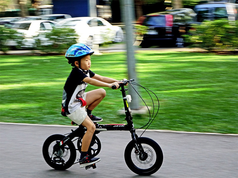 Kid ride on a bicycle