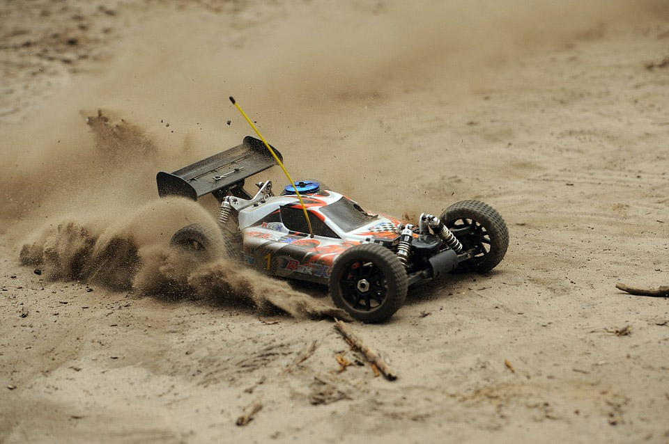 A RC car's running on sand
