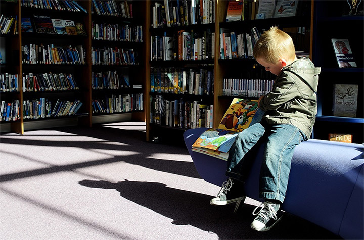 Kid in a library
