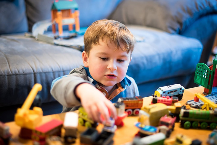 The boy plays wooden toys